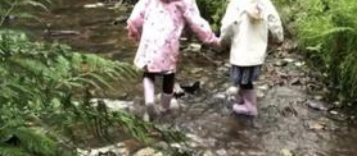 girls in a stream